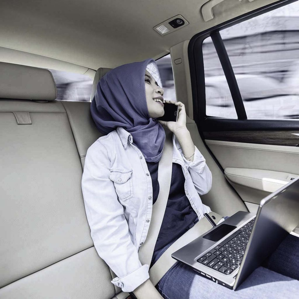 the lady talking on phone while personal driver is driving